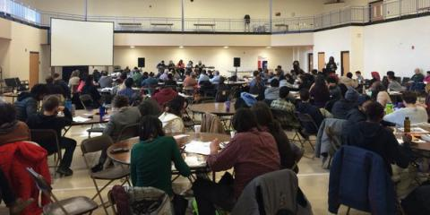People listening to a presenter at the North American Solidarity Economy Forum.
