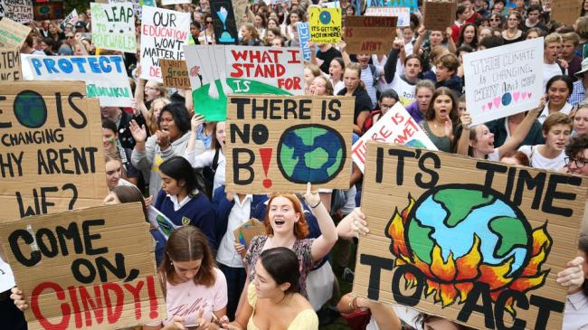 Students marching in the street for the climate strike.